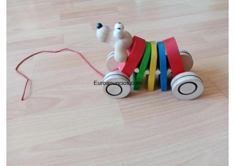 Juguete de perrito corredor